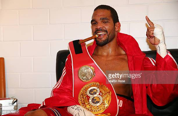 Yoan Pablo Hernandez of Germany poses in the changing room with a cigar after winning the WBO International IBF Cruiserweight World Championship...