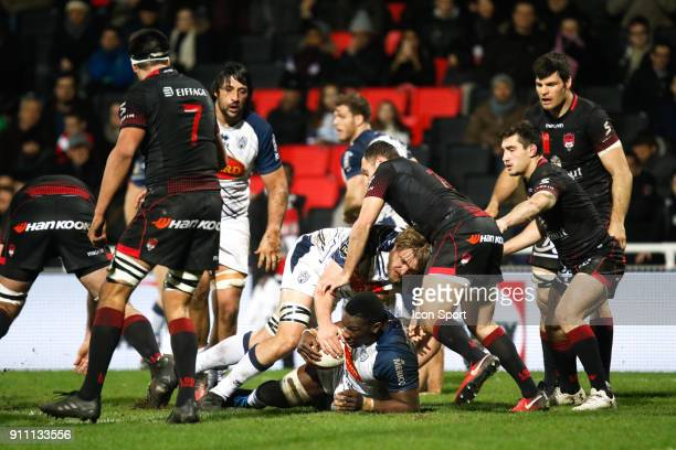 Yoan Tanga Mangene of Agen and Thomas Murday of Agen and Lionel Beauxis of Lyon and Baptiste Couilloud of Lyon during the Top 14 match between Lyon...