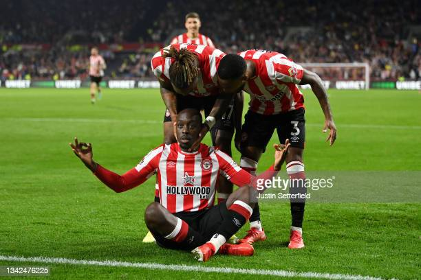 Yoane Wissa of Brentford celebrates scoring his sides third goal with Ivan Toney and Rico Henry during the Premier League match between Brentford and...