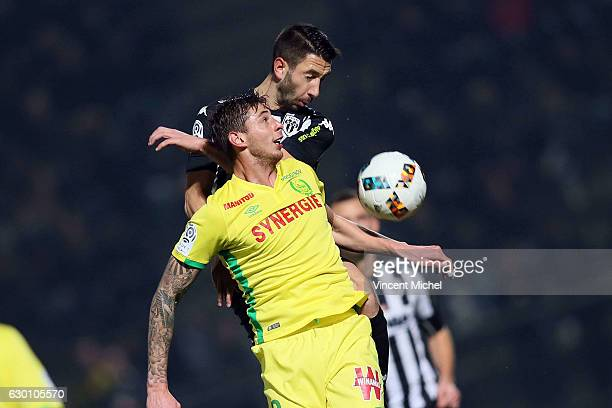 Yoann Andreu of Angers and Emiliano Sala of Nantes during the French Ligue 1 match between Angers and Nantes on December 16 2016 in Angers France