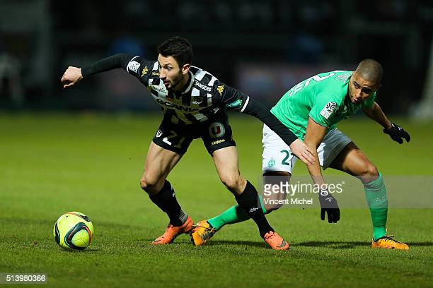 Yoann Andreu of Angers and Kevin Monnet Paquet of SaintEtienne during the French Ligue 1 match between Angers SCO v AS SaintEtienne at Stade...