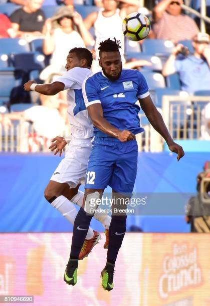 Yoann Arquin of Martinique jumps to head a ball against Nicaragua during the first half of a CONCACAF Gold Cup Soccer match at Nissan Stadium on July...