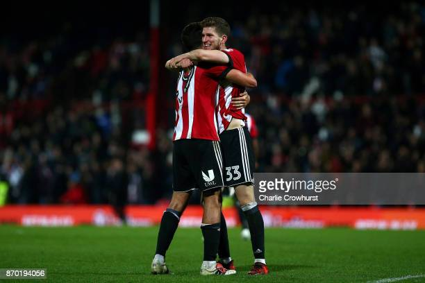Yoann Barbet and Chris Mepham of Brentford celebrate the teams win at the final whistle during the Sky Bet Championship match between Brentford and...