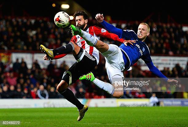 Yoann Barbet of Brentford FC and Lex Immers of Cardiff in action during the Sky Bet Championship match between Brentford and Cardiff City on April 19...