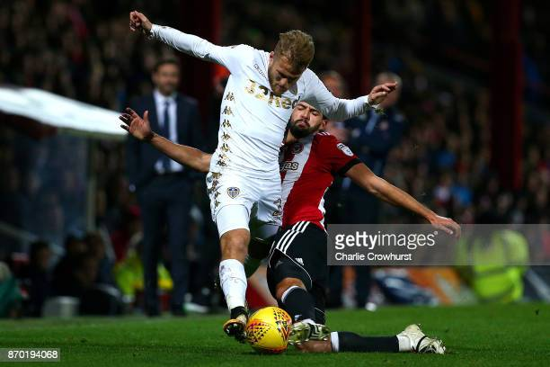 Yoann Barbet of Brentford puts a tackle in on Leeds Samuel Saiz during the Sky Bet Championship match between Brentford and Leeds United at Griffin...