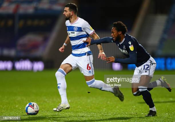 Yoann Barbet of Queens Park Rangers is challenged by Mahlon Romeo of Millwall FC during the Sky Bet Championship match between Queens Park Rangers...