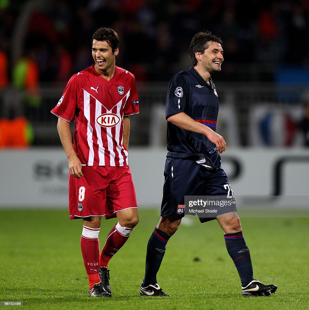 Yoann Gourcuff (l) of Bordeaux jokes with Jeremy Toulalan (r) of Lyon during the Lyon v Bordeaux UEFA Champions League quarter-final 1st leg match at the Stade de Gerland on March 30, 2010 in Lyon, France.