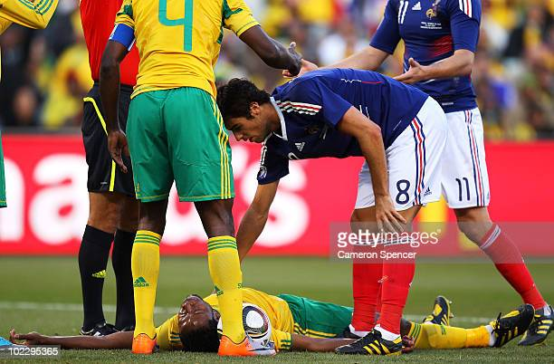 Yoann Gourcuff of France checks on MacBeth Sibaya of South Africa following a hard challenge which earnt him a red card during the 2010 FIFA World...