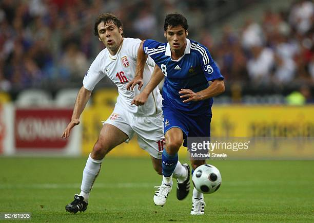 Yoann Gourcuff of France escapes the challenge of Ivan Ergic of Serbia during the FIFA 2010 Group Seven World Cup Qualifying match between France and...