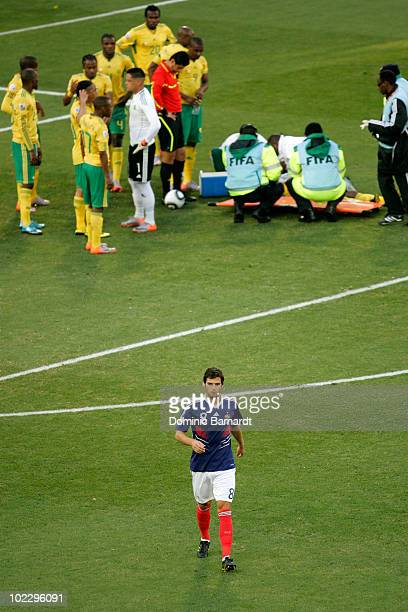 Yoann Gourcuff of France leaves the field after being given a red card following a challenge on MacBeth Sibaya of South Africa during the 2010 FIFA...