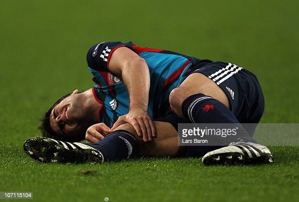 Yoann Gourcuff of Lyonnais lies injured on the pitch during the UEFA Champions League group B match between FC Schalke 04 and Olympique Lyonnais at...