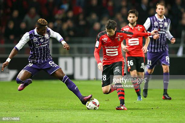 Yoann Gourcuff of Rennes and Francois Moubandje of Toulouse during the French Ligue 1 match between Rennes and Toulouse at Roazhon Park on November...
