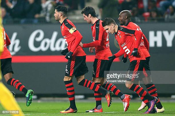 Yoann Gourcuff of Rennes celebrates with teammates after scoring the first goal during the French Ligue 1 match between Rennes and Toulouse at...