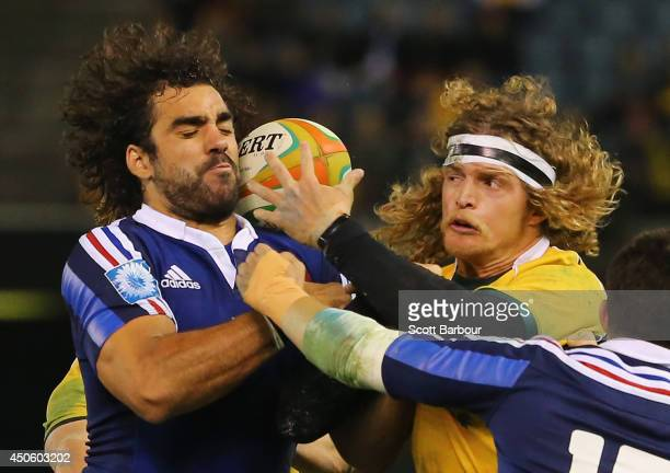 Yoann Huget of France and Nick Cummins of the Wallabies compete for the ball during the second International Test Match between the Australian...