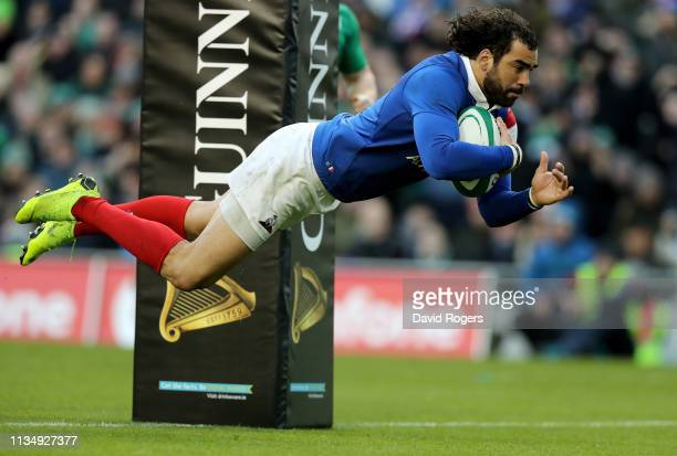 Yoann Huget of France dives to touch down a try during the Guinness Six Nations match between Ireland and France at Aviva Stadium on March 10 2019 in...