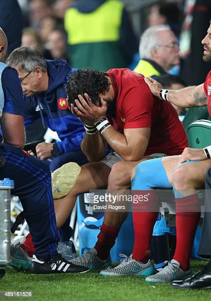 Yoann Huget of France is distraught following his injury during the 2015 Rugby World Cup Pool D match between France and Italy at Twickenham Stadium...