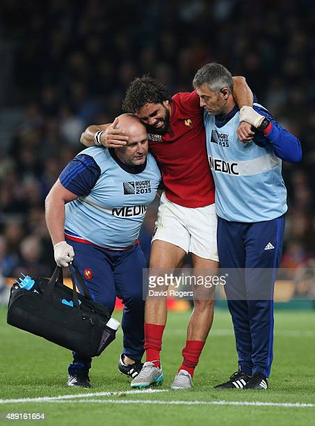 Yoann Huget of France is helped from the field following his injury during the 2015 Rugby World Cup Pool D match between France and Italy at...