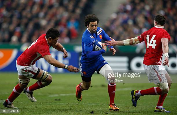 Yoann Huget of France is tackled by Toby Faletau and Alex Cuthbert of Wales during the RBS Six Nations match between France and Wales at Stade de...