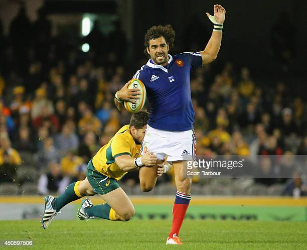 Yoann Huget of France is tackled during the second International Test Match between the Australian Wallabies and France at Etihad Stadium on June 14...