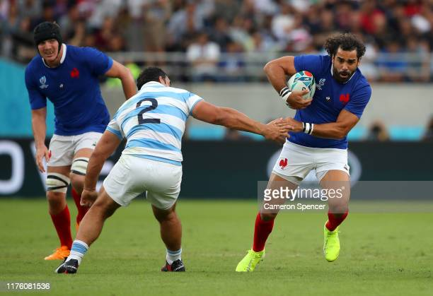 Yoann Huget of France runs past Agustin Creevy of Argentina during the Rugby World Cup 2019 Group C game between France and Argentina at Tokyo...