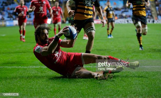 Yoann Huget of Toulouse dives for the ball during the Champions Cup match between Wasps and Toulouse at Ricoh Arena on December 8 2018 in Coventry...