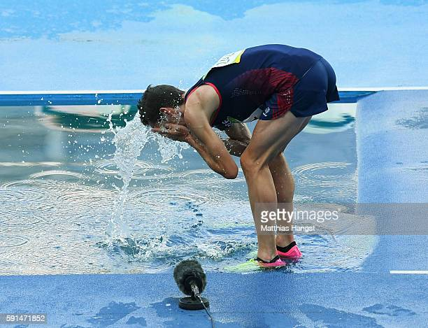 Yoann Kowal of France cools himself down in the water jump after he competes in the Men's 3000 metres Steeplechase on Day 12 of the Rio 2016 Olympic...
