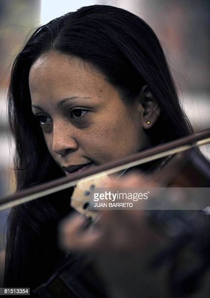 Yoanni Aldana an inmate of the women's prison Instituto Nacional de Orientacion Femenina plays the viola during music lessons inside the prison on...