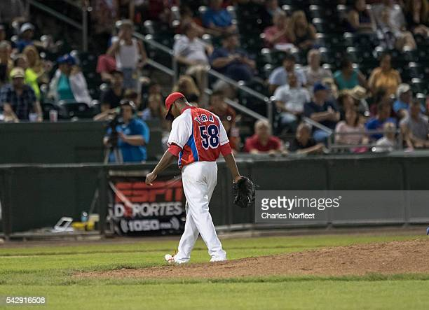 Yoanny Yera of the Cuban National Team walks off the field after being relieved of the pitching duties against the Rockland Boulders at Palisades...
