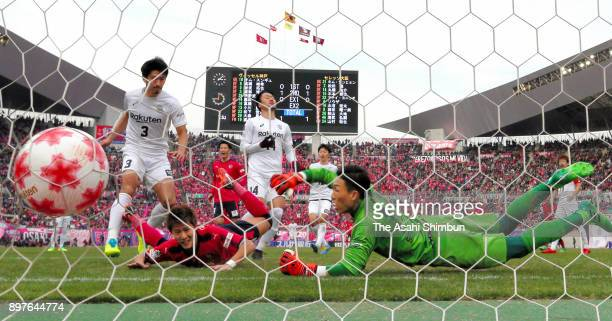 Yochiro Kakitani of Cerezo Osaka scores his side's second goal past Kim Seunggyu of Vissel Kobe during the 97th Emperor's Cup semi final match...