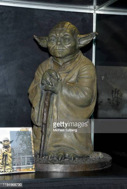 """Yoda statue belonging to actress Carrie Fisher at the Carrie Fisher pop-up museum """"The Todd Fisher Collection"""" at TCL Chinese Theatre on December 19,..."""