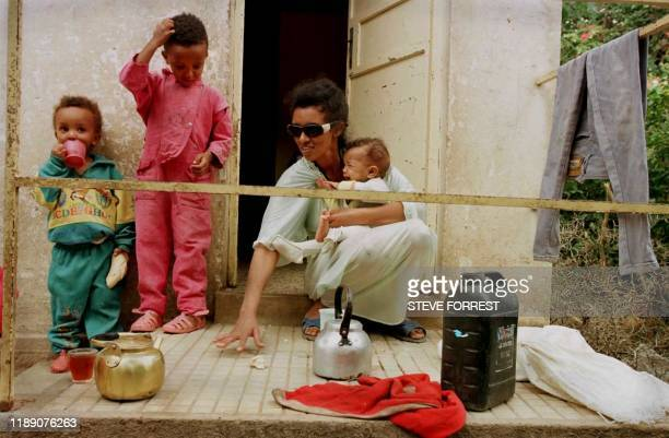 Yodit Yamane a 27year old Eritrean exfighter and mother of three takes care of her children in a camp for disabled exfighters 30km from Asmara in Mai...