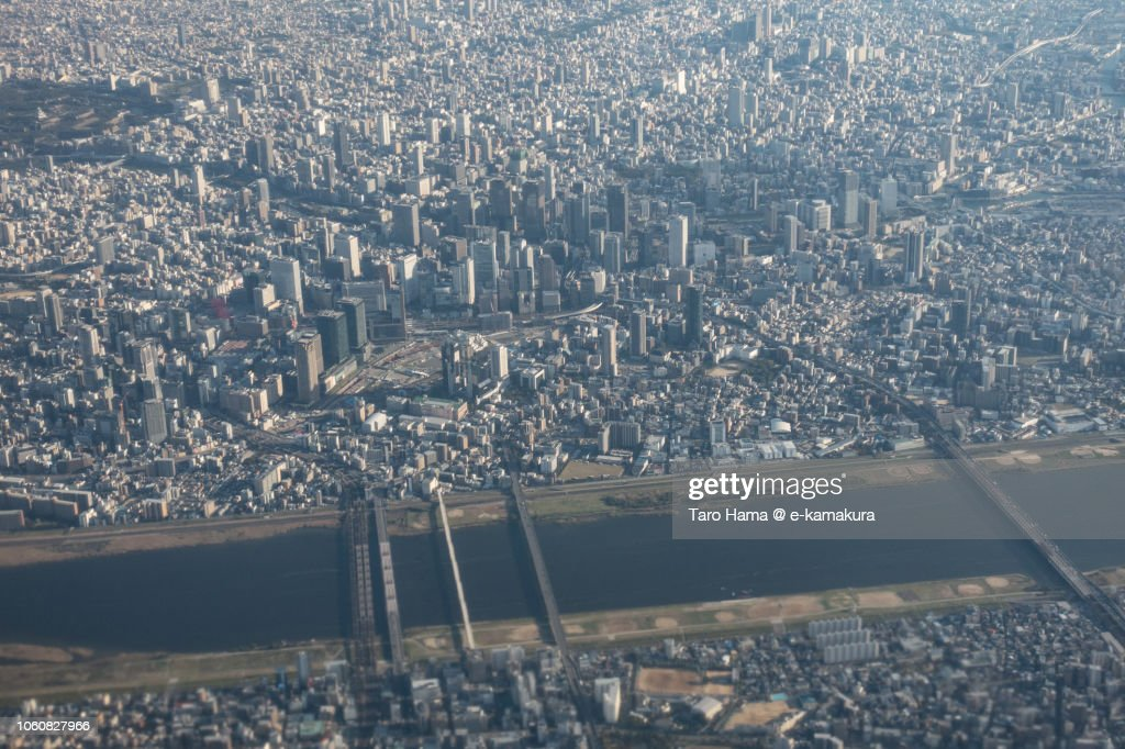 Yodo River and Osaka city in Japan sunset time aerial view from airplane : ストックフォト