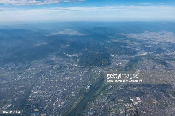 Yodo River, Hirakata and Takatsuki cities in Osaka prefecture in Japan daytime aerial view from airplane