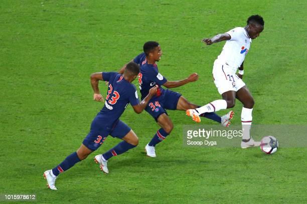 Yoel Armougom of SM Caen and Antoine Bernede of Paris Saint Germain and Colin Dagba of Paris Saint Germain during the French Ligue 1 match between...