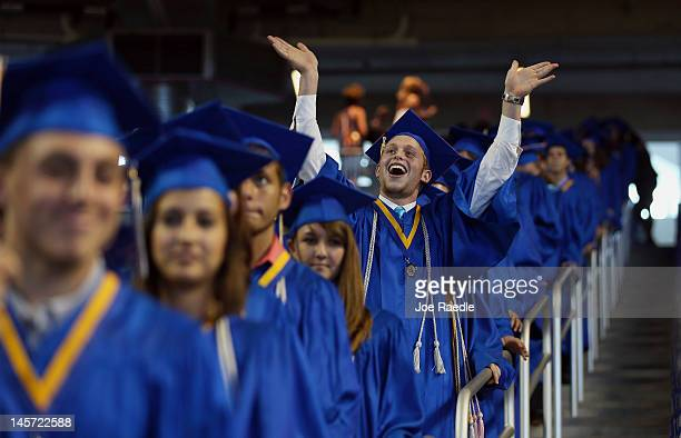 Yoel Lapsher and other graduates arrive for the graduation ceremony were Vice President Joe Biden spoke during the commencement ceremony for Cypress...