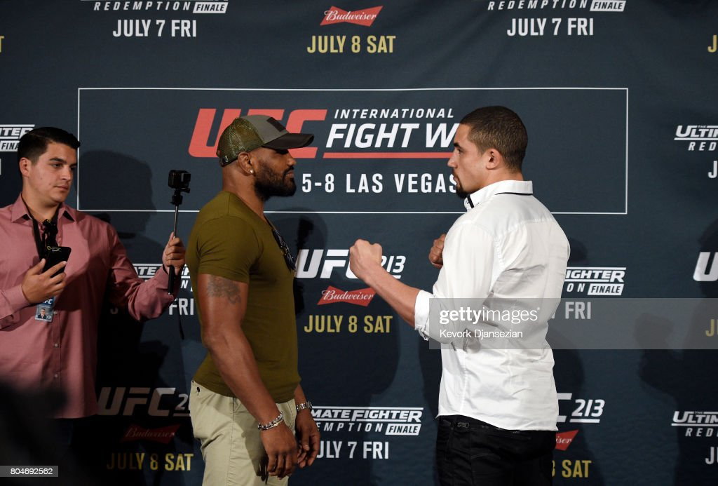 Yoel Romero (L) and Robert Whittaker face off during the UFC International Fight Week Media Day June 29, 2017, in Los Angeles, California.