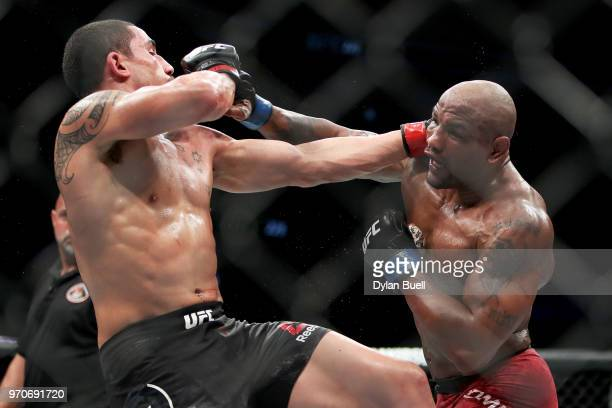 Yoel Romero of Cuba and Robert Whittaker of New Zealand each attempt a punch in the fifth round in their middleweight title fight during the UFC 225...