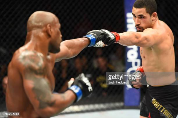 Yoel Romero of Cuba and Robert Whittaker of New Zealand touch gloves at the start of round two in their middleweight fight during the UFC 225 event...