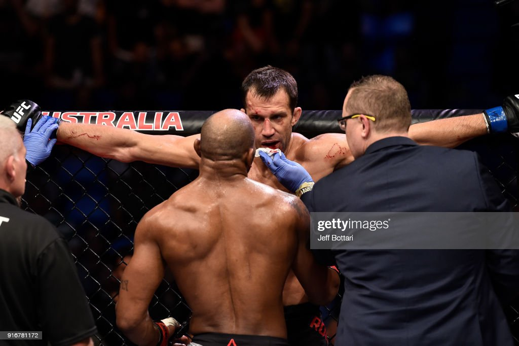 Yoel Romero of Cuba checks on Luke Rockhold in their interim middleweight title bout during the UFC 221 event at Perth Arena on February 11, 2018 in Perth, Australia.