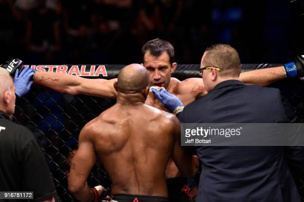 Yoel Romero of Cuba checks on Luke Rockhold in their interim middleweight title bout during the UFC 221 event at Perth Arena on February 11 2018 in...