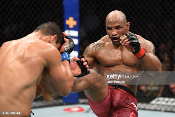 Yoel Romero of Cuba kicks Paulo Costa of Brazil in their middleweight bout during the UFC 241 event at the Honda Center on August 17 2019 in Anaheim...