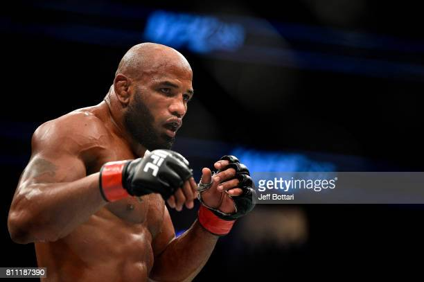 Yoel Romero of Cuba looks to strike Robert Whittaker of New Zealand in their interim UFC middleweight championship bout during the UFC 213 event at...