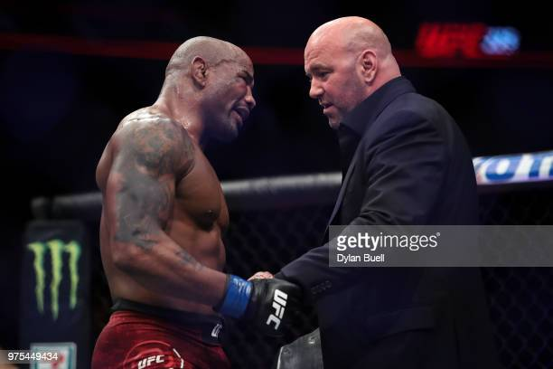 Yoel Romero of Cuba meets with UFC President Dana White after his middleweight title fight against Robert Whittaker of New Zealand during the UFC 225...
