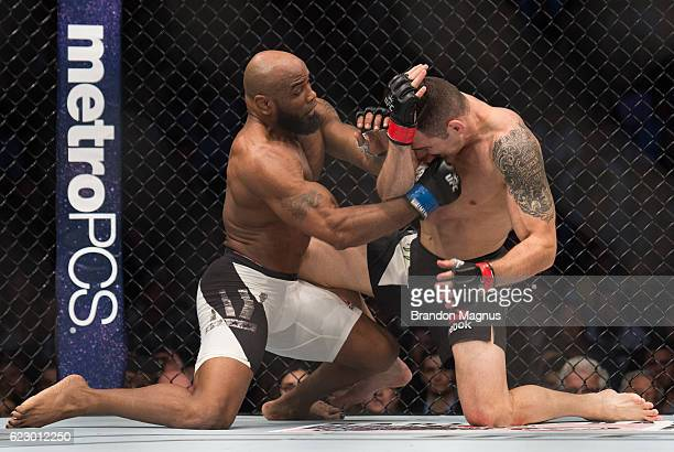 Yoel Romero of Cuba punches Chris Weidman in their middleweight fight during the UFC 205 event at Madison Square Garden on November 12 2016 in New...
