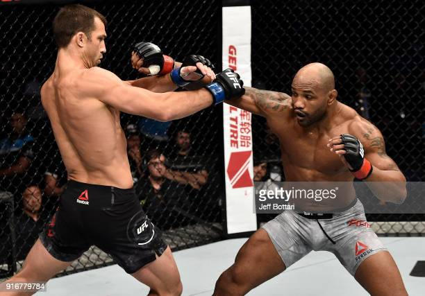 Yoel Romero of Cuba punches Luke Rockhold in their interim middleweight title bout during the UFC 221 event at Perth Arena on February 11 2018 in...