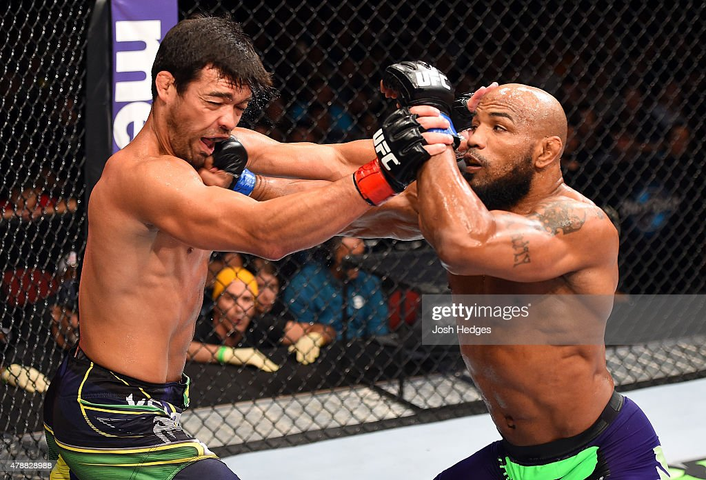 Yoel Romero of Cuba punches Lyoto Machida of Brazil in their middleweight during the UFC Fight Night event at the Hard Rock Live on June 27, 2015 in Hollywood, Florida.