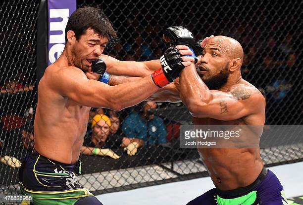 Yoel Romero of Cuba punches Lyoto Machida of Brazil in their middleweight during the UFC Fight Night event at the Hard Rock Live on June 27 2015 in...
