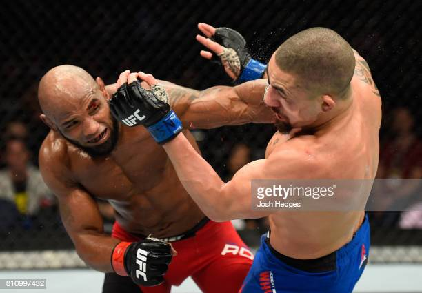 Yoel Romero of Cuba punches Robert Whittaker of New Zealand in their interim UFC middleweight championship bout during the UFC 213 event at TMobile...