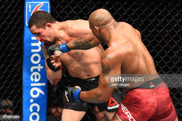 Yoel Romero of Cuba punches Robert Whittaker of New Zealand in their middleweight fight during the UFC 225 event at the United Center on June 9 2018...