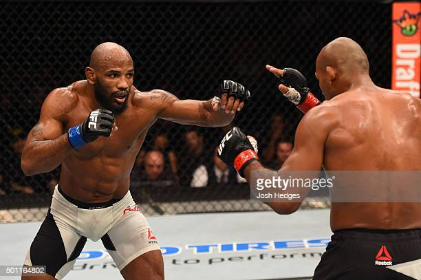 Yoel Romero of Cuba punches Ronaldo 'Jacare' Souza of Brazil in their middleweight bout during the UFC 194 event inside MGM Grand Garden Arena on...